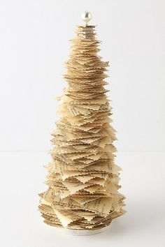 "Printed Paper Pine $48.00 Anthropologie - "" The tree, stacked high with printed squares, reads as our most literary holiday decor."""