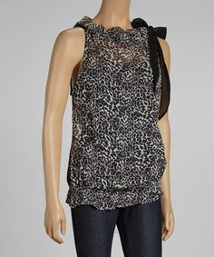 Come into fashion with this posh top! Boasting a fierce print and a sheer design, it will be a strut-worthy closet keeper.
