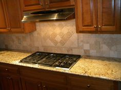 Kitchen Backsplashes with Granite Countertops | Gold Granite Kitchen Countertops With Tumble Marble Backsplash Tiles ...