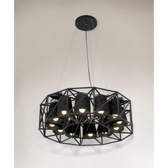 Seletti Ring hanging lamp with 12 lampshades - Black. This hanging lamp by Emmanuel Magini has been constructed in powdered metal to create an industrial feel.