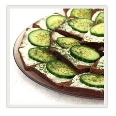 CUCUMBER SANDWICHES 1 (8 oz.) pkg. softened cream cheese 1 stick butter, softened 1 pkg. mild Italian dressing mix 1 (8 oz.) loaf party rye bread 2 cucumbers, unpeeled & thinly sliced Dill weed for garnish