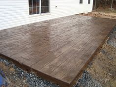Patio idea. I'm loving the stamped concrete that looks like wood