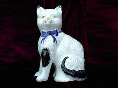 """19th C. Staffordshire Cat Figure from the Antiques Depot. Small (7 3/4""""). But very sweet. Also pricey ($US 550)."""