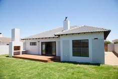 A small scale home in a quiet cul-de-sac in Langebaan Country Club, which overlooks the Langebaan Country Eco Estate with total privacy Glass And Aluminium, Building Contractors, Grey Houses, Deck Patio, Timber Wood, Large Windows, Green Grass, South Africa, Lawn