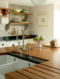 wonder if we did have wooden worktop whether we could protect it with the granite behind the sink