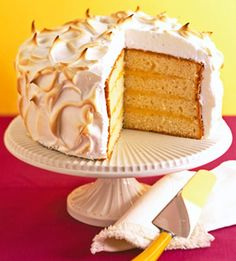 Lemon Meringue Cake - Instead of using icing, frost this lemon-filled cake mix fix-up with a soft meringue and bake in a hot oven until the swirls of meringue are golden.