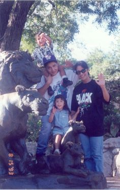 Selena and Chris with AB Quintanilla two kids. Rare photo