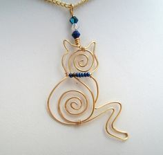 This lovely little kitty cat pendant necklace has been created by hand using gold plated wire, glass crystal beads & seed beads. She is hung on an 18 inch gold plated chain & comes in a gift box. The approximate height of this pussy pendant is . Cat Jewelry, Animal Jewelry, Wire Jewelry, Jewelry Design, Diy Jewellery, Wire Rings, Jewelry Ideas, Jewlery, Wire Wrapped Necklace