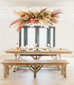 How to Throw a Boho Meets Rustic Friendsgiving hanging pampas grass installation / fall party Wedding Reception Ideas, Reception Decorations, Wedding Table, Wedding Aisles, Wedding Ceremonies, Hanging Flower Arrangements, Hanging Flowers, Diy Hanging, Floral Arrangements