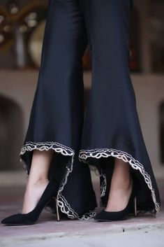 These black raw silk high low flared trousers with gold hand embroidery and cutwork are perfect fusion to match with Eastern as well as Western styles. Pakistani Fashion Party Wear, Pakistani Dresses Casual, Pakistani Dress Design, Black Pakistani Dress, Designer Party Wear Dresses, Kurti Designs Party Wear, Indian Designer Outfits, Stylish Dresses For Girls, Stylish Dress Designs
