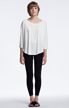Groceries Apparel Willy Tee is a loose fitting long sleeved tee with scalloped hi-low bottom hem that looks and feels easy-breezy. A low scoop neck in front and a high scoop in back. Made in Californi