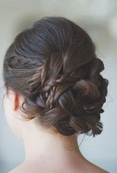 The updo itself is created from several smaller braids and mixes layers of plaited and non-plaited sections.
