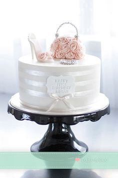 A very romantic and chic shoe and handbag cake