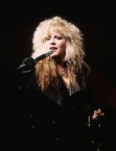 "December 1985: Stevie and Grace Slick join Heart onstage to perform back-up vocals on their hit ""What About Love"" (crappy audience recording)."