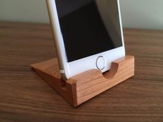 This stylish iPhone 6 stand is handmade using cherry hardwood and finished with three coats of a durable oil/varnish blend followed by paste wax—all applied by hand and the same finish I use for high-end furniture. The finish will withstand heavy use even in the kitchen. The stand is cut to precise dimensions to securely hold an iPhone 6 without a case. If you are interested in a stand or dock that can accommodate a phone in a case, take a look at my other products. www.etsy.com/sho...