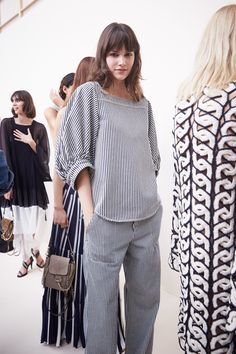 Each season, Chloé's Clare Waight Keller tweaks her staples slightly, updating them for the new contemporary Chloé girl. This year, that meant plenty of poofy, cupcake-like minidresses, but the lineup of such classics was punctuated by jumpsuits, matching sets, and a blazer or two. Less fussy, a little more polished. Go backstage at Chloé's airy-fairy Spring 2017 show in Paris with photographer Ambra Vernuccio to see for yourself.