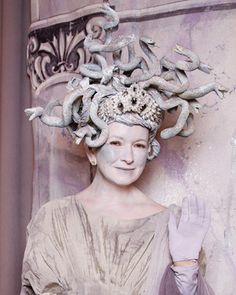"""Medusa, the Greek monster whose gaze could turn people into stone, was Martha's costume of choice for season 4 in 2008. An intricate and regal headpiece of snakes crowned her stone-colored costume. The show featured a mausoleum of audience members set in bronze, stone, and marble."""