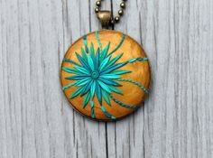Polymer Clay Pendant by Jitterbug.  Inspiration to try overlay method.