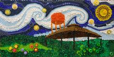 By Teresa Euken.  This is a recycled bottle cap mural (4'X8') that my K-3 students made. Our community has a Chautauqua pavillion and an orange water tower which are represented in the mural.