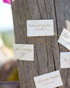 Michele Papineau of Papineau Calligraphy penned the escort cards. They were tucked into string wrapped around a teak tree stump along the pathway to the dinner tent.