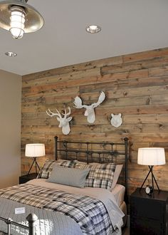 source: House of Fifty Rustic cabin style bedroom with reclaimed wood planked w. source: House of Fifty Rustic cabin style bedroom with reclaimed wood planked wall featuring a trio of faux taxidermy wildlife over iron bed dressed w. Farmhouse Master Bedroom, Master Bedroom Design, Master Bedrooms, Bedroom Boys, Girl Bedrooms, Trendy Bedroom, Country Girl Bedroom, Bedroom 2018, Bedroom Simple