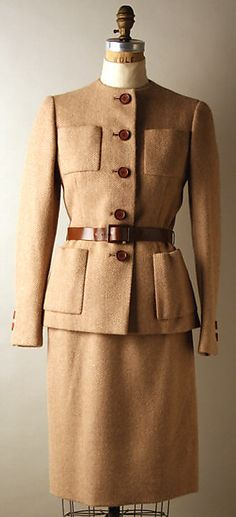 Tan wool suit (over ivory turtleneck), by Norman Norell, American, fall/winter 1972-73.