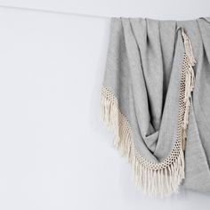 "Diamanta Throw - Dove Grey, handwoven in Peru by the Weavers of Huancavelia, 100% alpaca wool and edges finished with rows of hand-knotted macrame fringe, 70""L x 50""w (+7"" hand-knotted fringe), $135"