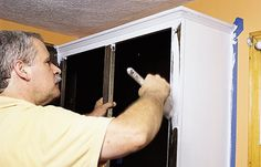 Surface prep is the key to a good kitchen paint job – so clean cabinets well, fill holes, sand, and vacuum before priming and painting.