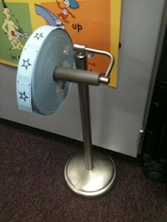 Use carnival tickets for classroom reward system...and use a free-standing toilet paper holder as a dispenser!