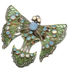 ENAMEL, OPAL AND DIAMOND BROOCH, CIRCA 1900 Designed as a stylised butterfly, set with green plique à jour enamel, cabochon opals, rose- and circular-cut diamonds, mounted in yellow gold and platinum, French assay marks, enamel deficient.