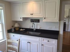 A beadboard backsplash in a seaside cottage couldn't be more perfect.