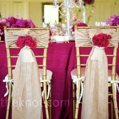 Champagne chair sashes accented with roses marked the couple's seats.