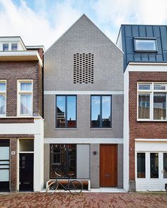 We might be back from our trip, but we just can't get enough. By setting an Amsterdam house a few feet back from the street, 31/44 Architects ensured the city's planning department that the new construction would not block light to the surrounding structures. The gray brick facade references the building material of choice in the formerly industrial neighborhood, which has seen a residential resurgence. #exterior #architecture #modern #dwell  Photo by @graydonpictures + @nikoleherriott…