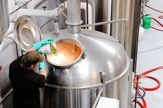 Lift Bridge Brewing adding pellets to the Brew Kettle.