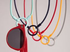 Eyeglass Holders, the Eyeglass Necklace from La Loop: La LOOP is a chic version of traditional eyeglass lanyards. The styles are fresh and modern, but that's just part of the appeal. The loop that holds your glasses is supported by hinges which swivel 360 degrees. The patented hinged design keeps glasses lying flat, so they won't twist or fall off even when you run, jump or dance..