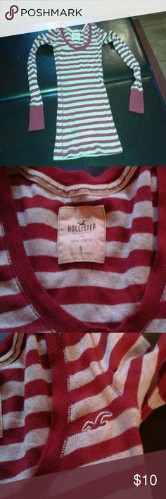 Cute Hollister shirt! Small hole toward the bottom but not too noticeable.  Lots of life left in this cute, warm top! Hollister Tops Tees - Long Sleeve