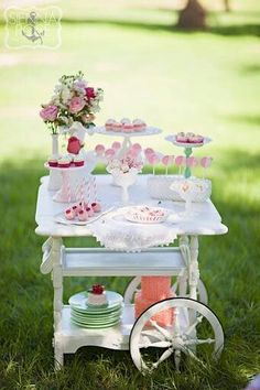 Tea cart full of goodies...contact us at Vintage Emporium Rentals for more unusual ideas for your wedding. Our team are all Visual Display Directors.