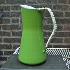 Dansk in a rare apple green! https://www.etsy.com/listing/158205581/super-rare-apple-green-dansk-enamel