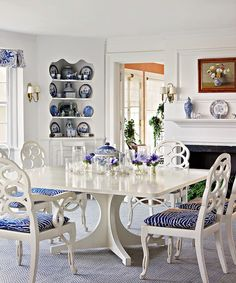I love when white furniture is painted in high gloss!  A blue and white dining - Tom Scheerer