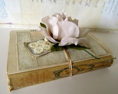 Vintage ephemera collection with french poetry book, handwritten letter, old mother of pearl buttons and music.