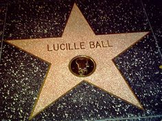 Have my picture taken next to Lucille Ball's star! :)