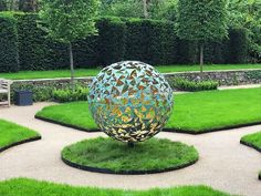 Mild Steel #sculpture by #sculptor Charles Elliott titled: 'Verdigris and Gold Sphere (Globe Ball sculpture)'. #CharlesElliott