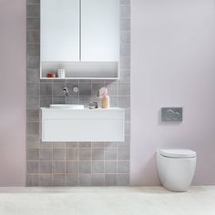 You don't have to get too fancy with in-wall toilets. Simple round buttons will do and they're a timeless addition to the bathroom. We really like these chrome ones from Geberit.