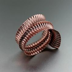 """""""Mi piace"""": 40, commenti: 4 - Copper Jewelry (@copperjewelry) su Instagram: """"Here's a conversation piece! With its sensual curves and corrugated texture and anticlastic…"""""""