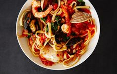 You can make the sauce the day before, then cook the pasta and seafood the next day to put it all together.