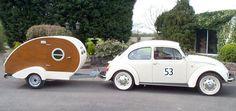 Too, too adorable. Image via http://www.vwcampervanblog.com/25-cool-vintage-retro-micro-caravans-to-compliment-your-vw-camper-van/