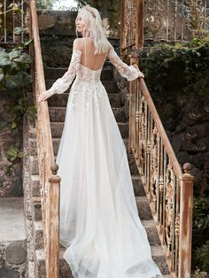 The stylish cold shoulder bishop sleeve princess wedding dress for the modern bride made by Maggie Sottero. Find your one-of-a-kind bridal gown today! Colored Wedding Dresses, Dream Wedding Dresses, Bridal Dresses, Wedding Gowns, Boho Wedding, Wedding Bride, Maggie Sottero Wedding Dresses, Bridal Lace