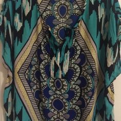 Beautiful Lightweight Turquoise Blouse Very lightweight and a little sheer (I always wore a cami under it).  Perfect for the office this summer.  It has discrete belt loops but does not come with a belt.  CLOSET SPECIAL!  Spend $50 and pick any item in my closet priced $14 or less for free! Pure Energy Tops Blouses