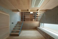 House in Nanakuma / MOVEDESIGN Wood, concrete and blue stair detail