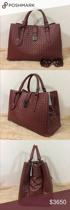 "Bottega Veneta Medium Roma In Russet Brand new with tag Authentic Bottega Veneta Medium Roma Satchel. Retail: $3750.00. Measures 15"" x 10"" x 7"". Three compartments. One interior zipper closure pocket. Pull over tab with push lock top closure. Suede lining. Comes with a key and key case. Brushed gunmetal hardware. Comes with a dust bag, care card in envelope and BV store tag attached. NO TRADES. Only reasonable offers please. Thank you. Bottega Veneta Bags Satchels"